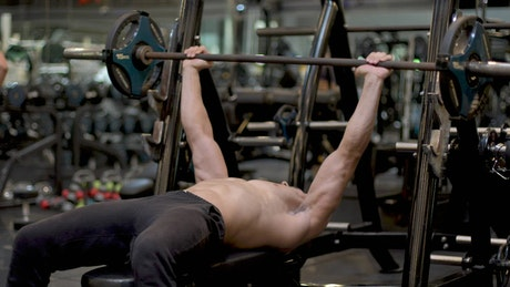 Man exercising with a dumbbell in a gym