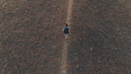 Man exploring the hills in autumn