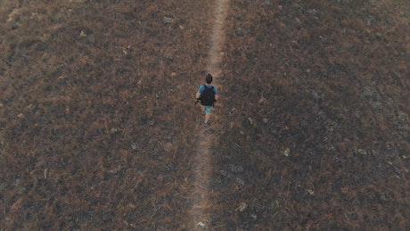 Man exploring the hills in autumn