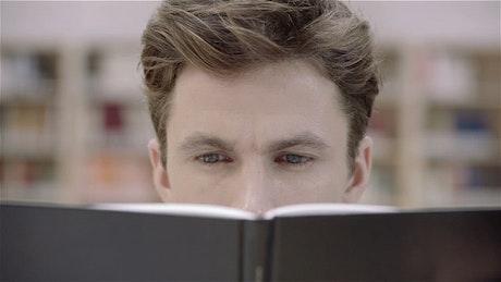 Man eyes reading a book