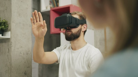 Man gestures with futuristic VR technology