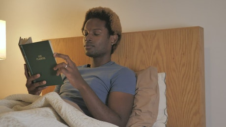 Man goes to sleep after reading