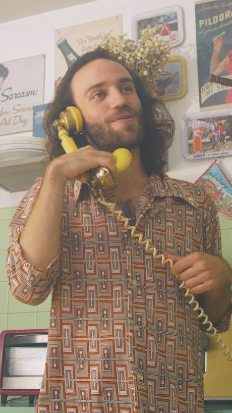 Man having a phone call at home