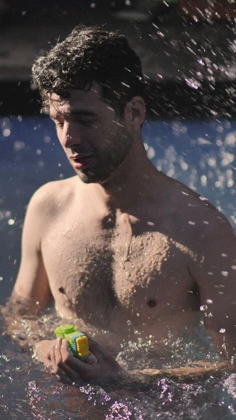 Man having fun in a swimming pool