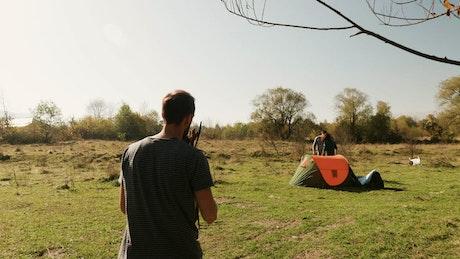 Man helps friends start fire on camping trip