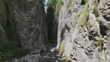 Man hiking in a canyon river