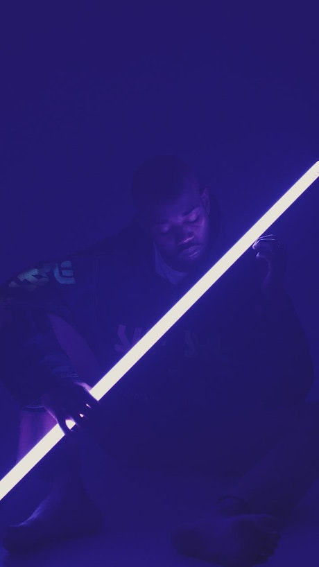 Man holding neon light