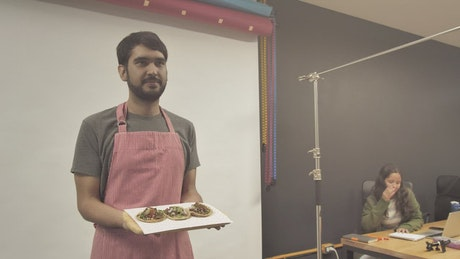Man in a photo studio holding food