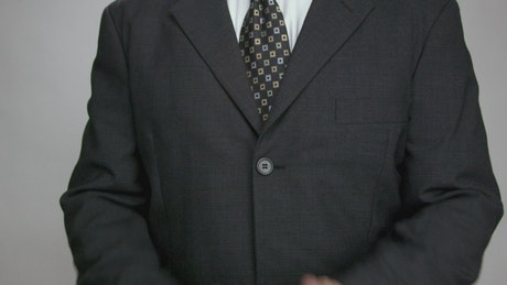 Man in a suit clapping
