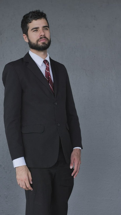Man in a suit giving a firm handshake