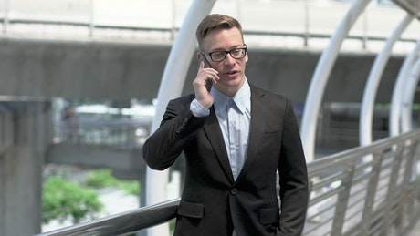 Man in a suit talking on his mobile phone
