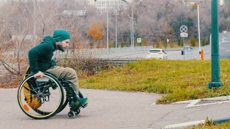 Man in a wheelchair attempt to pass the ramp