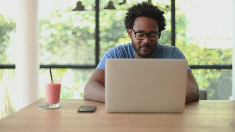 Man in front of computer working from home