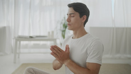 Man in peaceful mind meditation at home