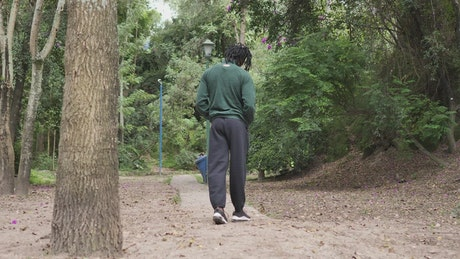 Man in sportswear walking scattered through a forest