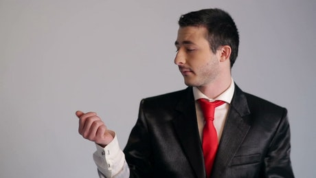 Man in suit being whimsical