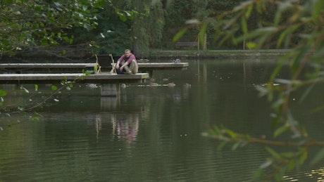 Man in the lake dock walks away