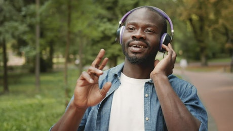 Man inspired by music in headphones sings along