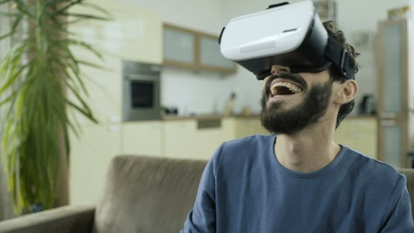 Man laughing hysterically with virtual reality