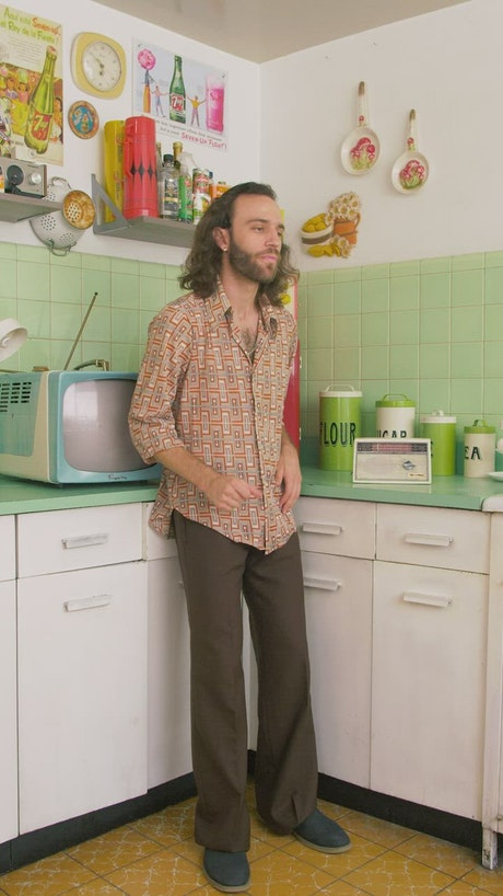 Man listening radio and dancing in the kitchen