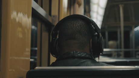 Man listening to music on the subway