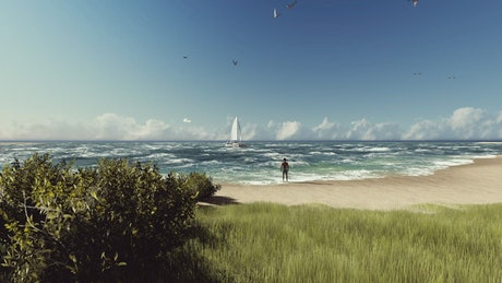 Man looking at a sailboat on the beach