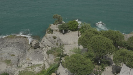 Man looking down over cliffs
