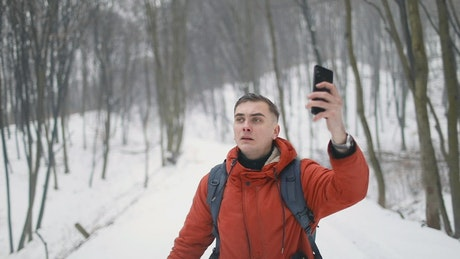 Man lost in forest looking for cell signal