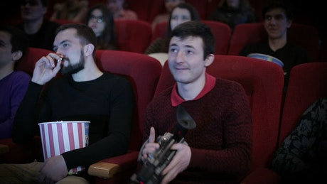 Man making movie piracy in cinema
