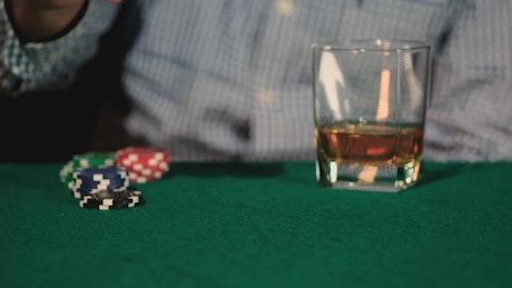 Man mixing dice in a gambling game