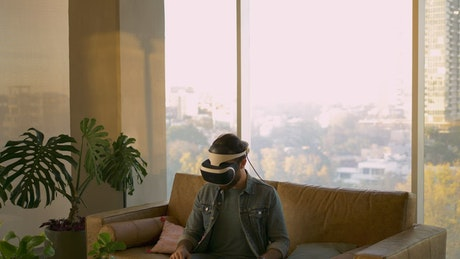 Man moves with virtual reality glasses