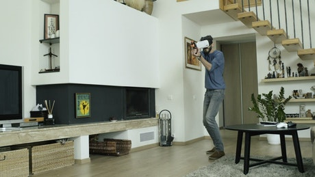 Man playing a shooter video game in VR