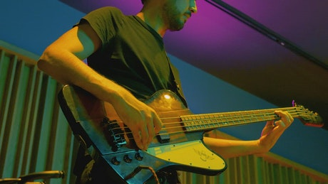 Man playing bass during a live performance