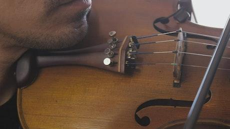 Man playing violin close up
