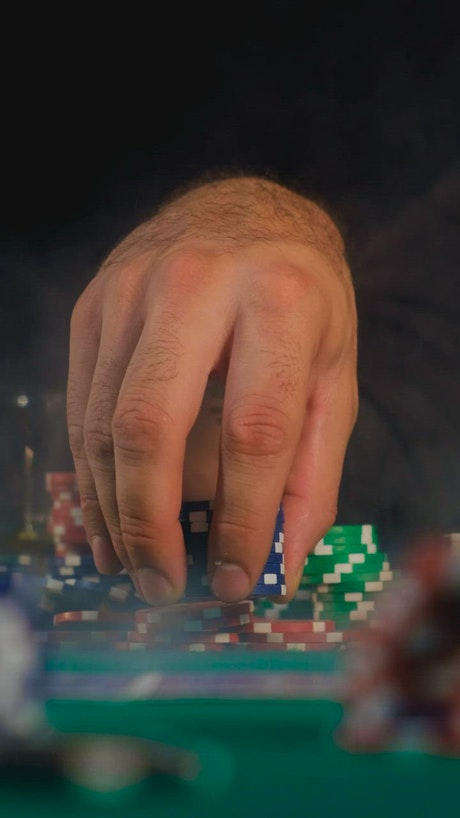 Man playing with a tower of poker chips