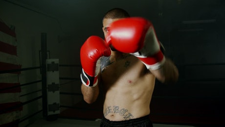 Man punching with red boxing gloves