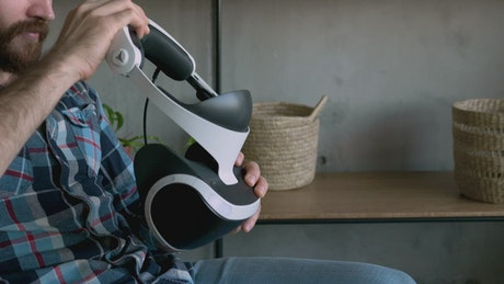 Man puts on virtual reality glasses