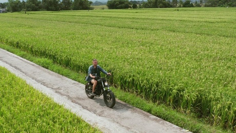 Man riding a motorbike in the countryside