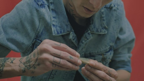 Man rolling up a cannabis joint