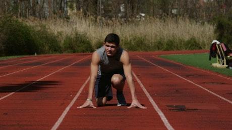 Man running down a track