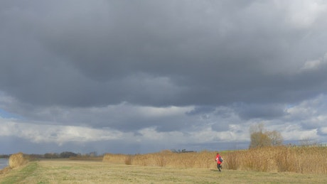 Man running on a cloudy day