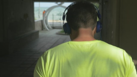 Man running through an urban building