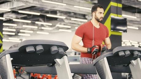 Man runs on weight loss machine in gym