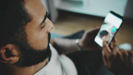 Man scrolling a social media app