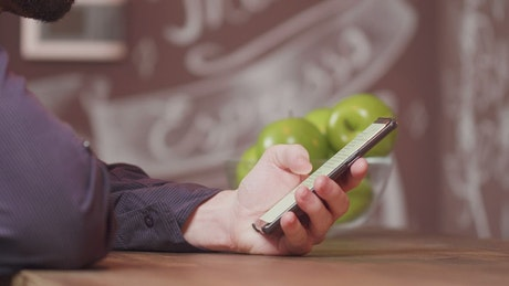 Man scrolling through his cellphone