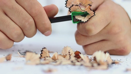 Man sharpening a pencil