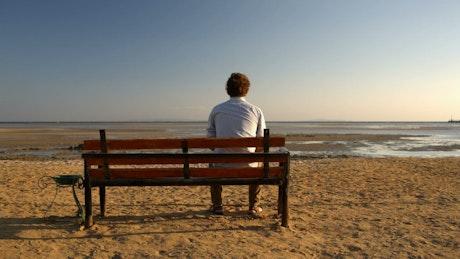 Man sitting alone on a bench