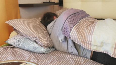 Man sleeping through the day