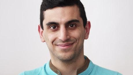 Man smiling brightly