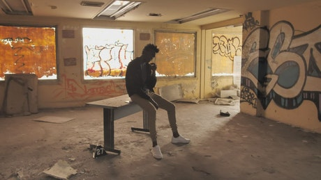 Man smoking in an abandoned building